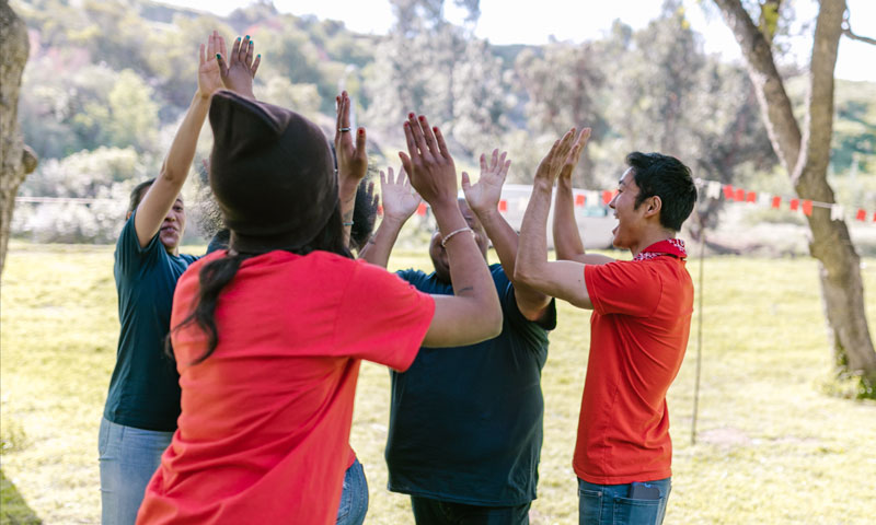 Family's hands giving high fives. FPH's Resource Families Support Services